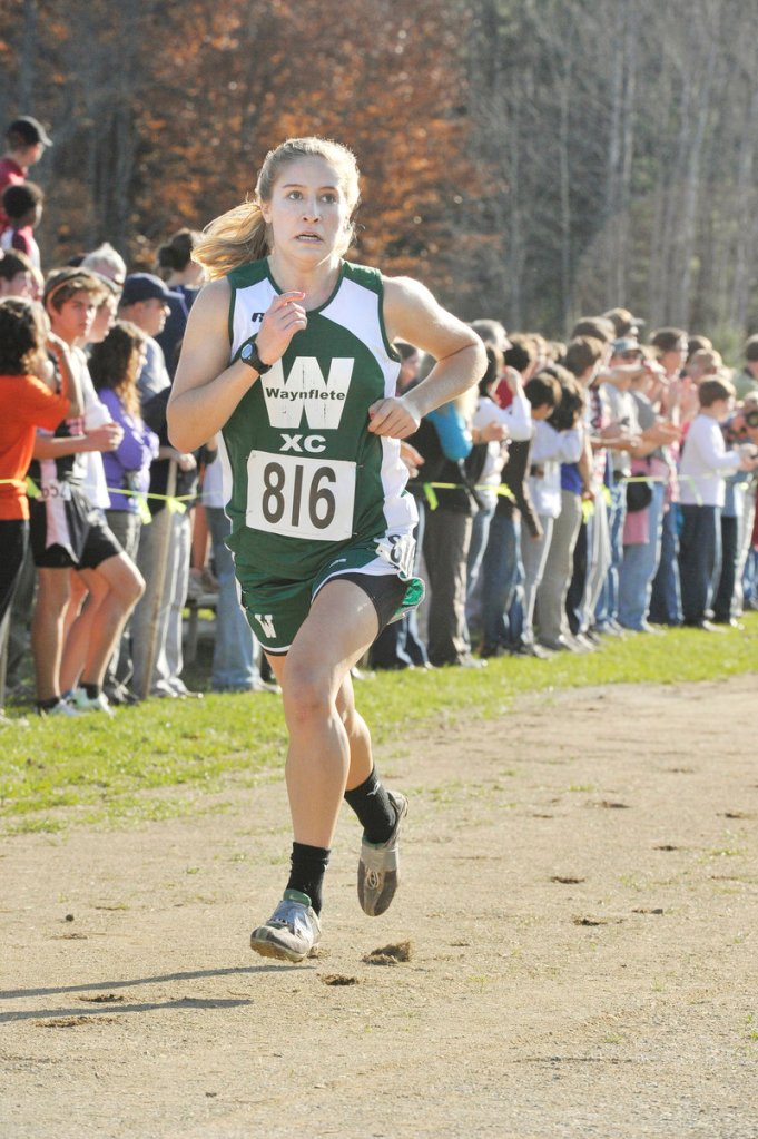 Martha Veroneau of Waynflete nears the finish line in the Class C race. The Flyers were third, one point behind second-place Orono.