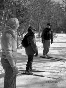 INSTRUCTOR JOHN HODGES helps beginners learn the basics of cross country skiing at Hidden Valley Nature Center.