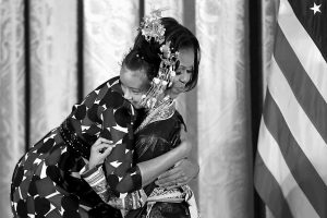 FIRST LADY MICHELLE OBAMA hugs Wu Lianyun, 13, of China, as she accepts the International Spotlight Award for China's The 100 Dong Songs Program during the President's Committee on the Arts and the Humanities (PCAH) National Arts and Humanities Youth Program Awards on Monday in the East Room of the White House in Washington. The International Spotlight Award this year recognizes The 100 Dong Songs Program, an initiative of the Western China Cultural Ecology Research Workshop.