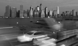 EARLY MORNING TRAFFIC in New York's Brooklyn borough moves slowly beneath the Manhattan skyline today.