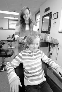 SISTERS Emma Burt, 9, and Madison Burt, 15, often go to their mom's place of work, Topsham Hair Care at 122 Main St., on Saturdays. When they are there, the two get to use the different hair products and tools and try things out on each other. Emma goes to Harriet Beecher Stowe and loves art. Madison attends Brunswick High School and her favorite class is photography. They are both looking forward to Thanksgiving, when Emma plans to eat all the turkey she can and Madison will save room for dessert since her favorite holiday treat is Rice Crispies treats with peanut butter and chocolate frosting.