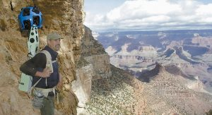 GOOGLE OPERATIONS MANAGER Steve Silverman stands along a canyon wall wearing the trekker during a demonstration for the media on the Bright Angel Trail at Grand Canyon National Park in Arizona.