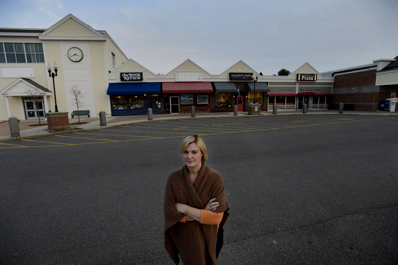 Elizabeth Moss, owner of Elizabeth Moss Fine Art Gallery and Framing in Falmouth, believes new limits on store sizes restrict options for potential future businesses.