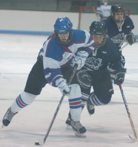 MT. ARARAT FORWARD Kayla Pinkham, left, top photo, skates past Portland/Deering's Katie Rutherford during a girls high school hockey contest at Sidney J. Watson Arena on Tuesday. In the bottom photo, Mt. Ararat's Hannah Zimmerman (25) skates up the ice while being defended by Portland/Deering's Gabi Carbona. The host Eagles fell 8-5 in their first home game since becoming a varsity team this season.