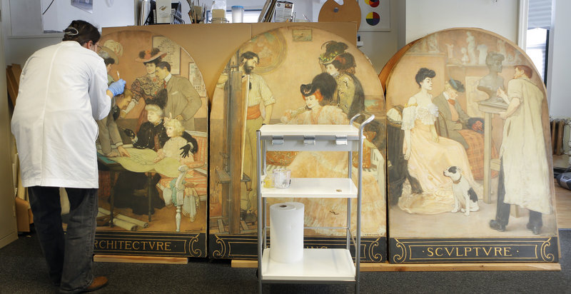 Senior conservator Katrina Jacques cleans a painting at the Maine Project for Fine Art Conservation, a painting restoration and conservation nonprofit in Portland.