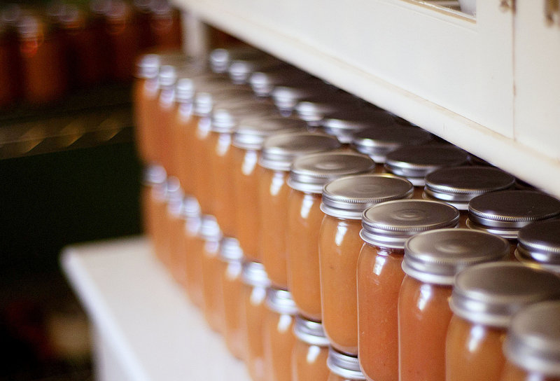 Applesauce cools on a side-board in what was the pantry of the Wixson home.