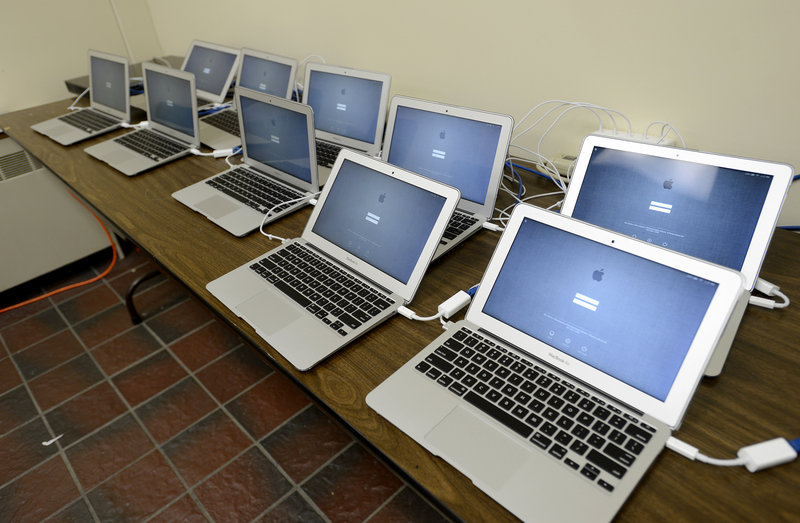Some of the new Apple computers for the Portland Public School students set up and ready for distribution at the Computer Technology Services Department on Wednesday, Dec. 12, 2012.