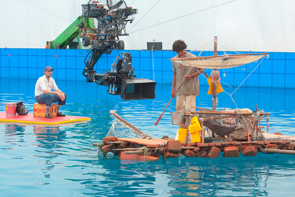 """Steven Callahan served as marine consultant on the movie """"Life of Pi."""" Steve Callahan of Lamoine, in cap, working on filming of """"Life of Pi."""""""