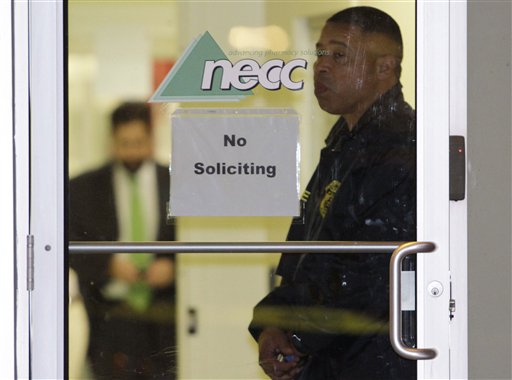 In this Oct. 16, 2012 file photo, a Food and Drug Administration Agent stands at the doorway of New England Compounding Center in Framingham, Mass., Tuesday, Oct. 16, 2012, as investigators work inside. The company's steroid medication was been linked to a deadly meningitis outbreak in one of Massachusetts's top stories in 2012.