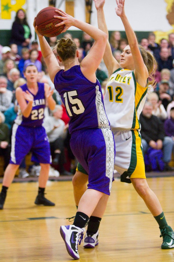 LeeAnn Downs (15) is pressured by McAuley's Sarah Clement during first-quarter action of Friday's game that was suspended just minutes into the first period.