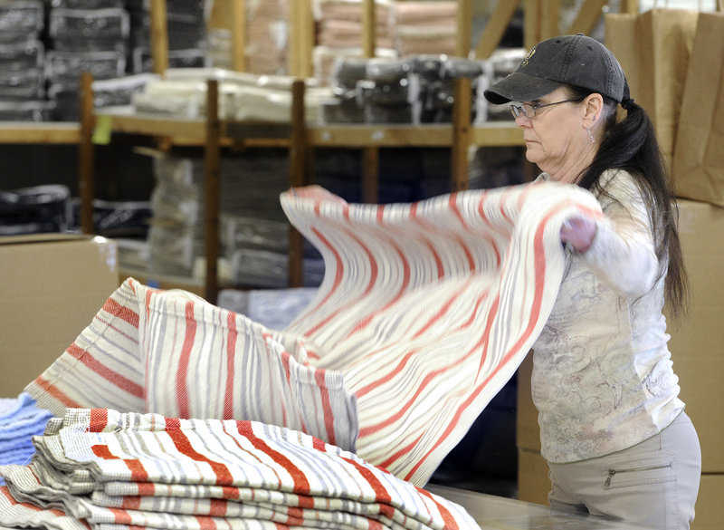 Phylis Martin gives a blanket a final inspection at Brahms Mount.