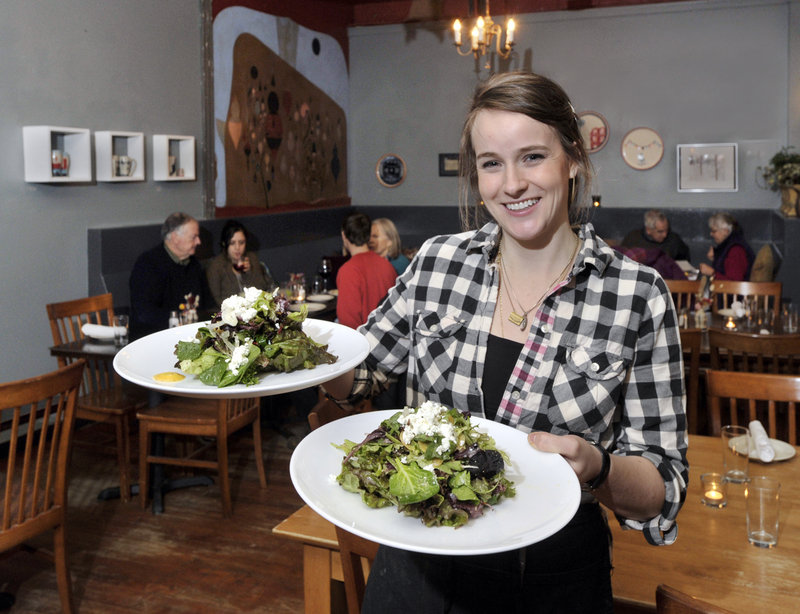 Server Cole Nadeau serves up green salads of market vegetables, local goat cheese, roasted garlic and dijon dressing. The four-star meal is made even better by an atmosphere that accommodates every taste and style.