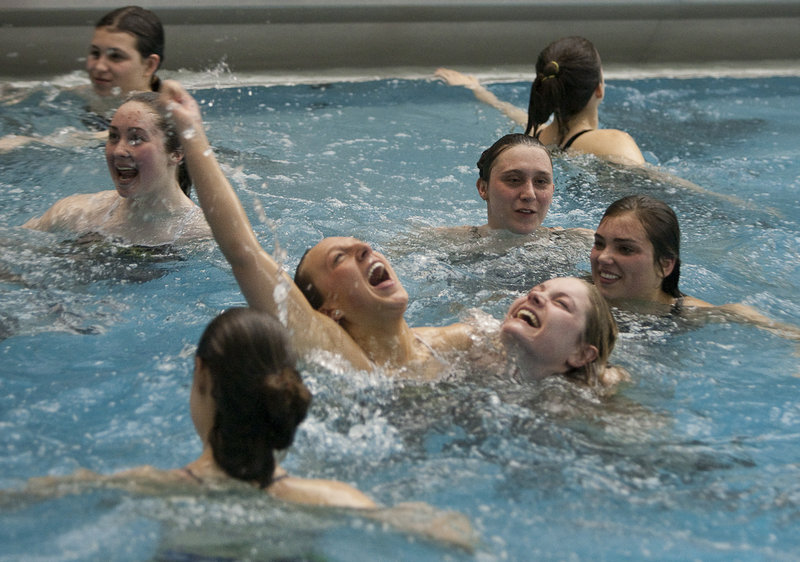 The Cape Elizabeth girls hold a team victory swim in the Bowdoin College pool in Brunswick after capturing the Class A state championship Tuesday night. Brunswick was second and Deering third, followed by Bangor and Cheverus.
