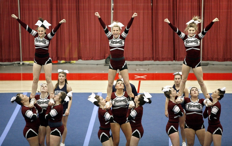Cheerleaders from Gorham High School complete a three-person pyramid during their routine at the Class A East/West State Cheerleading Competition in February 2012.
