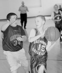 THE BRUNSWICK RECREATION DEPARTMENT'S Fifth-Grade Boys Basketball Tournament was held over the weekend. In the top photo, Brunswick's Evan Cox (15) is guarded by Gardiner's Dylan Spencer (34), while in the right photo, Brunswick's Jack Harvey (11) drives against Evan Wells (23) of Gardiner.