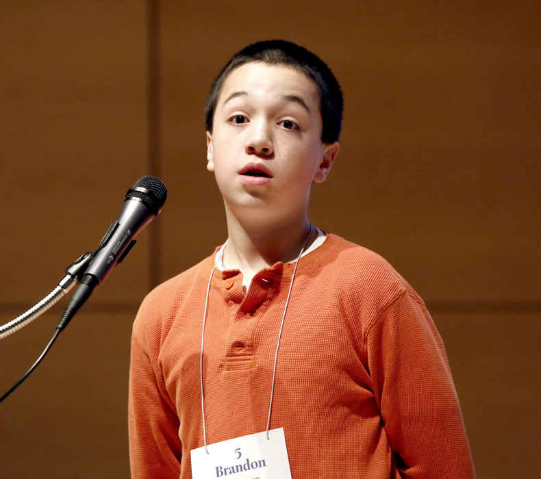 """Brandon Aponte, 12, representing Hancock County, reacts after being told he spelled the word """"crambo"""" correctly to win the Maine State Spelling Bee at the Hannaford Lecture Hall at the USM Portland campus on Saturday."""