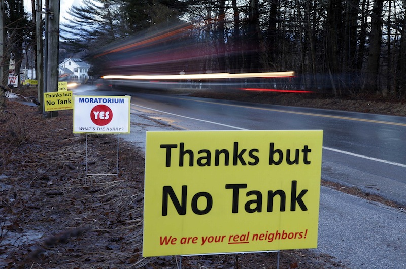 In this Friday, March 9, 2012 photo, signs in opposition to a proposed 23-million gallon propane tank are seen in Searsport, Maine. (AP Photo/Robert F. Bukaty)