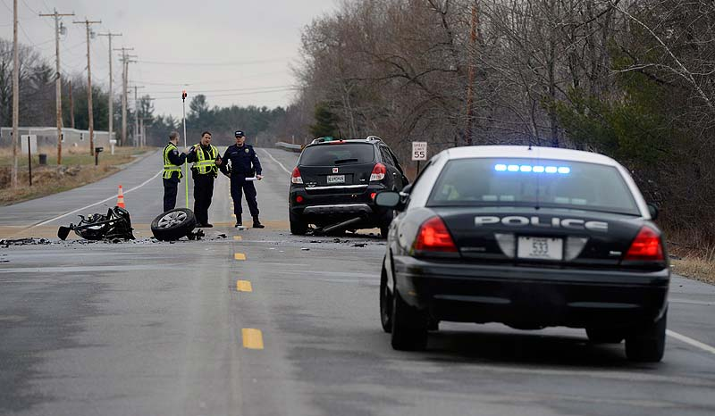 An accident reconstruction team examines the scene of a fatal crash on Route 4 in Berwick on Wednesday.