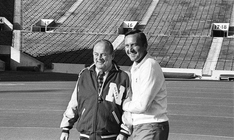 In this Nov. 24, 1971 file photo, Nebraska head coach Bob devaney, left, poses with Oklahoma head coach Chuck Fairbanks in Norman, Okla. Fairbanks, who coached Heisman Trophy winner Steve Owens at Oklahoma and spent six seasons as coach of the New England Patriots, died Tuesday, April 2, 2013, in Scottsdale, Ariz., after battling brain cancer, the University of Oklahoma said in a news release. He was 79. (AP Photo/File)