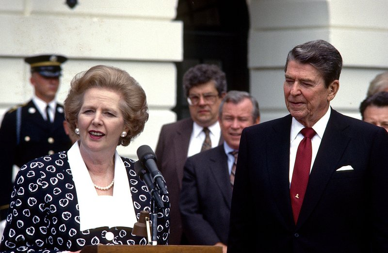 """British Prime Minister Margaret Thatcher offers remarks while visiting President Ronald Reagan in 1987. After Iraq invaded Kuwait, she told President George H.W. Bush """"this is not the time to go wobbly, George."""""""