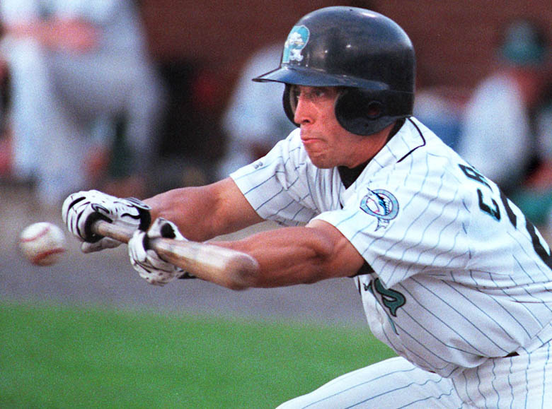 Staff Photo by Gordon Chibroski, Monday, July 10, 2000: Cesar Crespo, Seadog #21, bunts in an early inning and almost gets on by a close call. He was called out. Baseball action vs Norwich Navigators at Hadlock Field. Baseball Cesar Crespo Gordon Chibroski Sea Dogs