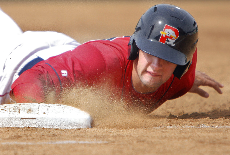 Gregory Rec/Staff Photographer: Alex Hassan dives back to first base in the third inning against the Reading Phillies at the Portland Sea Dogs at Hadlock Field on Sunday, April 10, 2011. Baseball