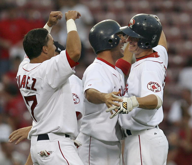 SPECIAL TO THE PORTLAND PRESS HERALD: Portland Sea Dogs Jay Johnson, right, is congratulated by teammates after knocking in the game winning run in the bottom of the ninth inning during the Futures at Fenway baseball game against the Harrisburg Senators, Saturday, Aug. 11, 2007 at Fenway park in Boston. (AP Photo/Mary Schwalm) Baseball