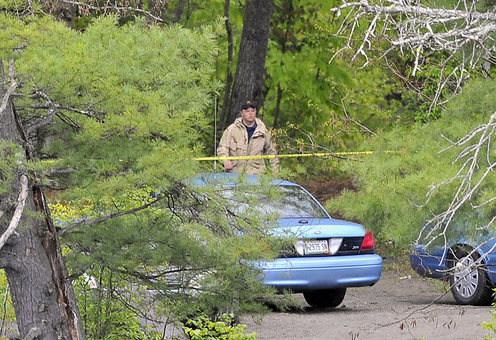 Maine State Police search the area on Tuesday where the body of Nichole Cable was found near the Stillwater River and Route 43 in Old Town. A member of the investigating group emerges from the woods where the body was found.