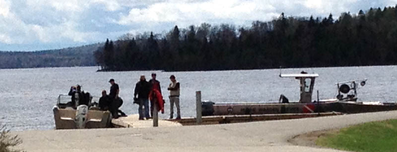 Maine Warden Service divers searched Rangeley Lake Thursday for three snowmobilers missing since winter.