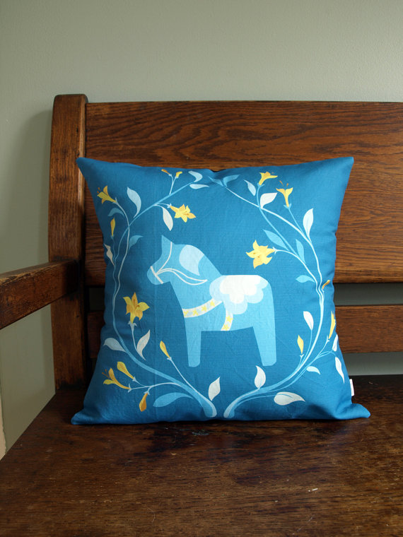 A pillow cover from Annika Schmidt of Portland features the Dala horse, a symbol of Swedish culture.