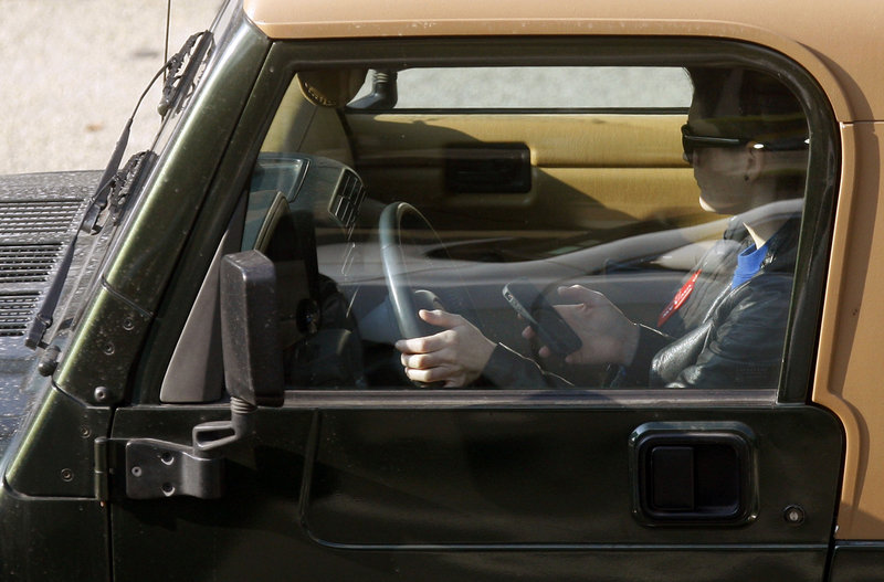 A driver uses an iPhone while negotiating Los Angeles traffic. Crashes that involve cellphone use are seriously underreported, according to a recent analysis by the National Safety Group, an advocacy group. New York state reported only one cellphone-involved fatal crash in 2011 and 10 in 2010.