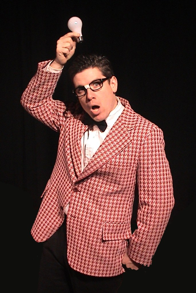 "Leland Faulkner as Wally Wiggins, above, and Mike Miclon as Dickie Hyper-Hynie, below, bring their entertainment expertise to the ""Geeky Edition of the Early Evening Show"" Friday and Saturday at the Freeport Theater of Awesome."
