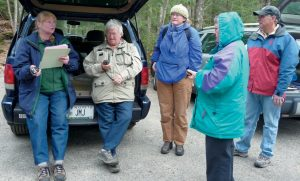 JOAN JANOWSKI, far left, will lead a free geocaching tour while exploring the Kennebec Estuary 9:30 a.m. to 11:30 a.m. Saturday, July 20. Meet at the Whiskeag Trail kiosk at the Bath YMCA to practice using Global Positioning System receivers to hide and seek containers known as geocaches or caches. Register at 442-8400 or bkolak@kennebecestuary.org.