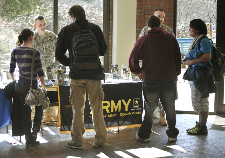 In this March 2012 file photo, U.S. Army recruiters Sgt. Stephen Wallace (left) and Sfc. Brandon Didier talk with students at the Portland Arts and Technology High School. Gov. Paul LePage's claim that military recruiters aren't allowed to wear their uniforms at Yarmouth High School is untrue, according to the principal of the school.