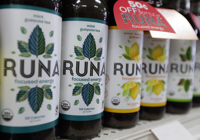 """Bottles of Runa energy drink line a shelf at Dean's Natural Foods store in Albany, N.Y. Runa's hit the shelves recently around the country, boasting caffeine from the guayusa """"super leaf."""" It supposedly provides as much caffeine as coffee, with more anti-oxidants than green tea."""