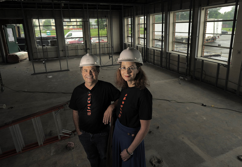"""Alan Spear and Mary Allen Lindemann, the married couple who co-own Portland's Coffee By Design, stand in the 40,000-square-foot warehouse on Diamond Street that they're converting into a """"playground for coffee geeks."""" Their fifth retail site represents a major expansion, taking the company – and the local coffee culture – to a new level."""