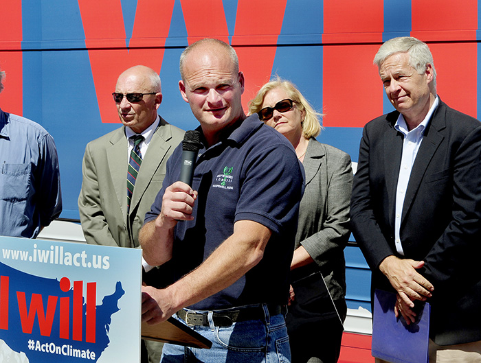 "Lobsterman Jim Merryman, owner of Potts Harbor Lobster Co., speaks at the ""I Will Act On Climate"" bus tour Monday in Portland's Monument Square. Other speakers included Portland Mayor Michael Brennan, U.S. Rep. Chellie Pingree, D-1st District, and U.S. Rep. Michael Michaud, D-2nd District, standing in background."