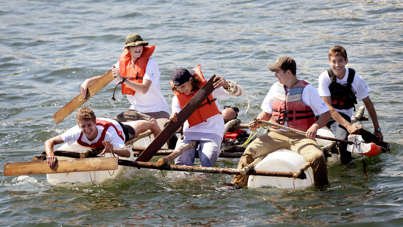 Science Island Extreme participants paddle a raft they built while on Little Chebeague Island. They are, from left, Tyler Sym of Lexington, Mass.; Adam Josselyn of Oxford Hills; Mario Conte of Long Island, N.Y.; Ryan McLaughlin of Kingston, N.H., and Galen DuBois of Woolwich.