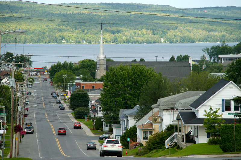 Just under 6,000 people live in Lac-Megantic. The downtown is situated on the shore of Lake Megantic at the bottom of a long hill. The railroad passes through the downtown along the shore. The lake itself is a depression in the Appalachian Mountains.