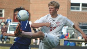 WISCASSET HIGH SCHOOL defender Kevin Lynch (22, top photo) gets his toe on the ball with Mountain Valley's Jared Arsenault close by in MVC soccer action on Monday. In the bottom photo, Wiscasset's Ethan James (23) and Mountain Valley's Andrew Boucher (15) battle for position, with Falcons midfielder Marcus Wrangberth (2) looking on. The host Wolverines rolled to a 5-0 win to improve to 1-1-1.