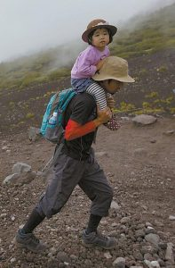 A JAPANESE MAN and his child climb one of the trails on Mount Fuji.