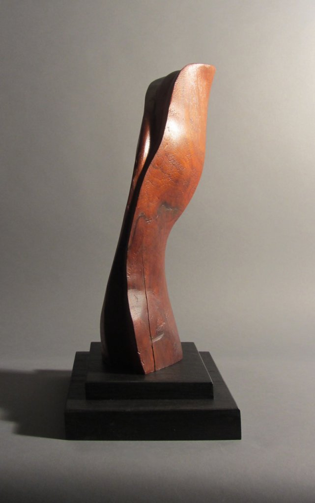 """Abstract Form"" by Robert Laurent, c. 1915, carved wood on a separate wood base."