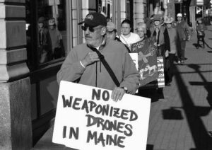 BRUCE GAGNON, of Bath, marches in the Maine Drone Peace Walk this weekend. The protest ends Saturday in Bath.