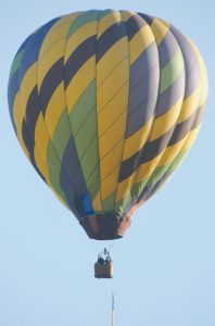 A HOT-AIR BALLOON drifts eastward over Freeport on Monday. Spotted above Hunter Road, the balloonist is a relative rarity for this time of year. A swift check of various airfields and potential landing spots proved fruitless, as none said they were expecting a balloon to touch down.