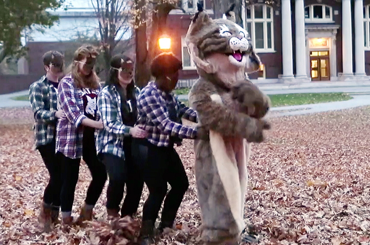 """In this screen capture from a video produced by Bates College, members of the Bates Modern Dancers follow a bobcat, the school mascot, through the Lewiston campus. The school's communications office says it made the video, """"to showcase the fun spirit and talent"""" of Bates students. The video answers the question, """"What does the bobcat say?"""""""