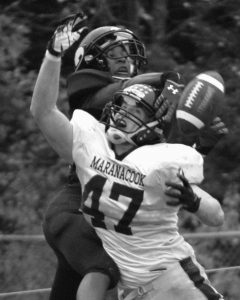 LISBON HIGH SCHOOL cornerback Tyler Halls breaks up this pass intended for Maranacook's Zach Bessette. The Greyhounds won 24-6 on Saturday to improve to 5-1.
