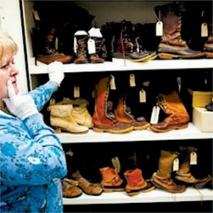 L. L. BEAN Archivist Ruth Porter opens a climate controlled locker containing historic and iconic footwear from the company's past in Freeport Tuesday.