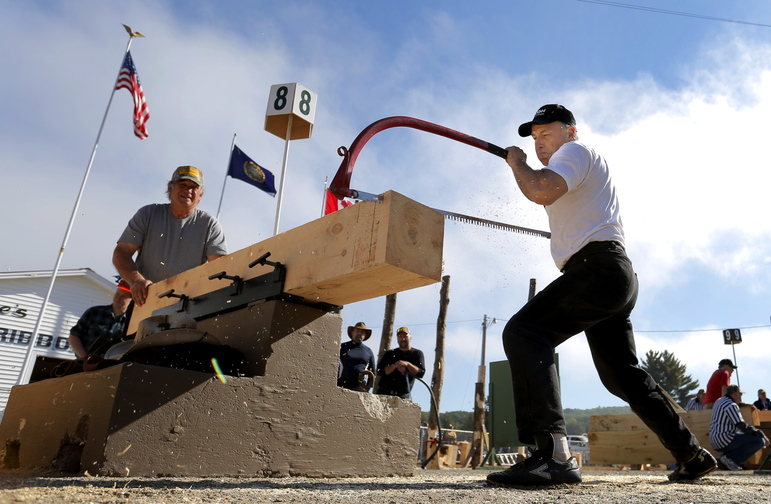 Donald Lambert of St. Gilles, Quebec, puts his all into the bucksawing competition at the Fryeburg Fair, which continues through next weekend.