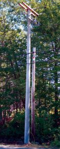 A NEW CONCRETE UTILITY POLE, set on South Harpswell Road in Harpswell last month, is being evaluated as part of a larger initiative to enhance the reliability of Central Maine Power Co.'s electric distribution system, utility officials said.