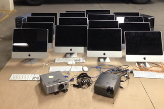 This photo furnished by the Portland Police Department shows Apple desktop computers recovered by police after a burglary at Hall Elementary School early Friday morning.